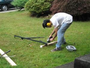 Leonard uses the angle grinder